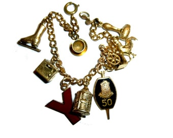 Vintage Gold-Tone Charm Bracelet. Ice Skate, Gavel, Tea Cup, Rooster, and More. Nine Charms.Very Cool.