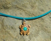 TINY TURTLE Hand Carved Pendant in Satin Wood with Turquoise