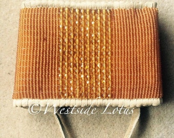 Amber dreams. Wide leather loomed beaded cuff.