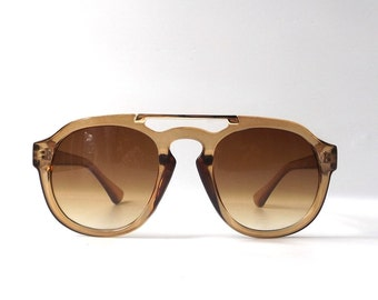 vintage 1990's NOS round clear brown plastic gold metal wire sunglasses womens mens fashion accessories accessory sun glasses retro modern