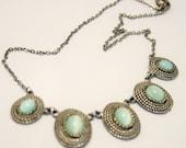 Vintage necklace.  Green satin glass necklace