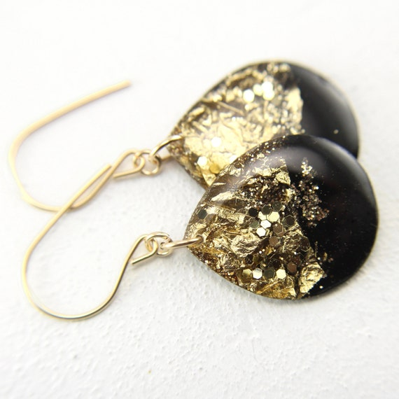black and gold glitter drop earrings on gold by tinygalaxies