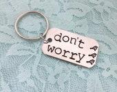 Don't Worry: bob marley 3 little birds lyrics dog tag keychain
