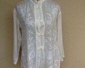 Vintage white rayon embroidered blouse.