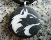 Husky design hand carved on a polymer clay black pearl color background. Pendant comes with a FREE 3mm necklace