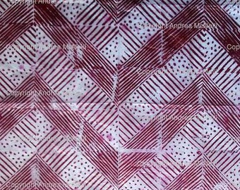 Sheet of white tissue paper handprinted in abstract lino design