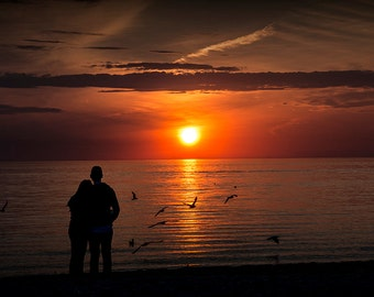 Romantic Couple watching the Days Last Light as the Sun Sets with Flying Gulls by Lake Michigan No.195 Fine Art Sunset Landscape Photography