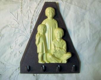 "Vintage Wall Plaque, Triangular Brown Plastic Key Holder, St. Labre Indian School, Ashland, MT, U.S., 4.5 x 4"""