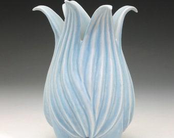 Carved tulip flower porcelain vase in pale blue glaze
