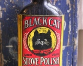 Black Cat Stove Polish. Vivid Paper Label with Black Cat Illustration. Vintage Bottle. Red Yellow.