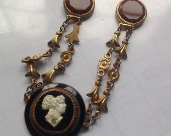 Victorian Enamel circular cameo brooch with goldstone accents    VJSE