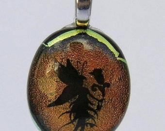 Fairy image dichroic glass pendant.
