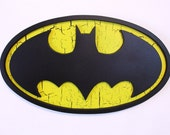 Batman fan art wall logo hand crafted from wood with a custom paint finish