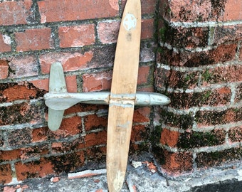 An Old Vintage Handmade Airplane That Has The Look