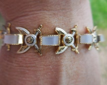 Vintage Gold Tone Damascene Bracelet Swords and Shields Mother of Pearl Safety Chain 1960s Shell Iridescent Asian Inspired Weapon