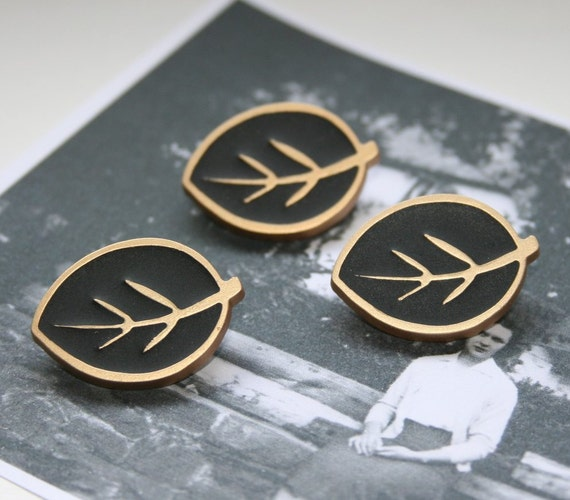 """Leaf buttons size approx 1"""" (25mm) long in cream or black, dating back to the 1980s"""