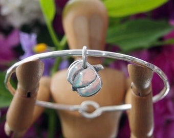 for your inner vampire hunter...a little fine silver garlic charm on a hand beaten sterling silver bangle..