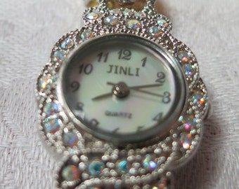 """Delicate lady's watch, 6"""" ins long, stamped JINLI, Japan mvt, water resistant, (Quartz), beaded  strap, jeweled setting, HMCHS12.11-15.3-8.1"""