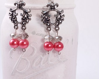 Gun metal adornment with red and smoky crystal glass dangle earring