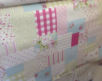 Fryetts vintage patch design in candy pink or blue by the half metre 100% cotton