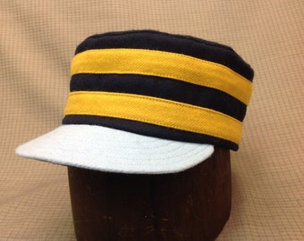 Custom made Vintage style  base ball boxcap. Navy Melton wool with gold wool bands. Baby blue short visor, cotton sweatband. Any size.