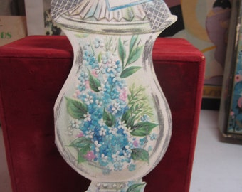 Gorgeous unused 1950's-60's die cut embossed silver gilded large jar shaped get well card with blue pink and white flowers inside