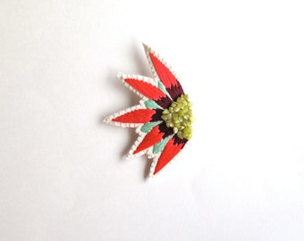 Abstract embroidered brooch starburst design with mint green and light and dark red colors with green serpentine gems Spring,Summer fashion