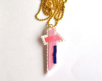 Cross necklace hand embroidered on cream muslin gold plated ball chain bright pink with cobalt blue glass bead details textile jewelry