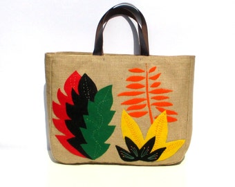 African flowers hand applique on jute, large tote bag, handmade, artistic, resort, book bag, beach bag, shoppers bag, one of a kind