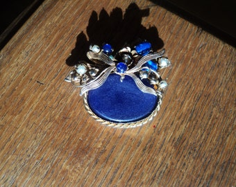 Antique Blue Lapis Stone Brooch on a wonderful gold plated metal floral relief design setting embellished  with faux pearls and blue stones