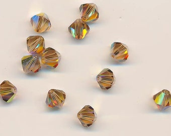 12 vintage Swarovski crystals - discontinued art 5301 - 8 mm - light colorado topaz AB