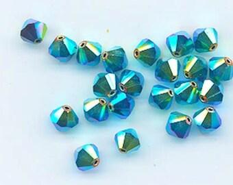 24 gorgeous Swarovski crystal beads - discontinued Art. 5301 - 6 mm - jet AB 2X