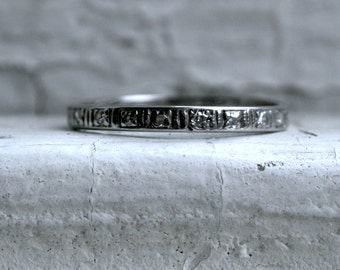 Stunning Vintage Etched Platinum Pave Diamond Wedding Band.