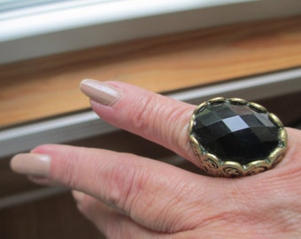 """Vintage Jewelry size 6 1/2"""" Ladie's multi faceted  black stone oval Ring adjustable antiqued brass toned finish  no markings"""