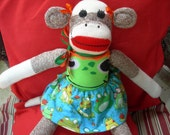 Red Heel Sock Monkey Girl Doll Dressed In Frog Sweater And Frog Skirt
