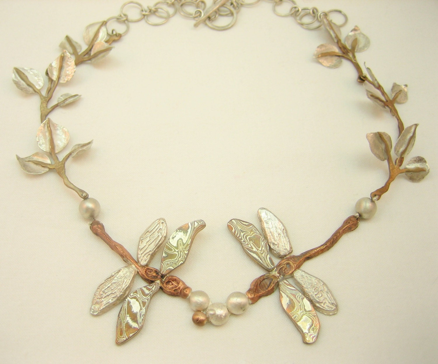 Handmade one of a kind metal and Mokume Gane dragonfly and hammered silver metal leaf necklace artisan made dragonfly statement necklace