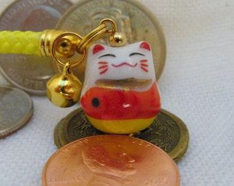 Maneki Neko Lucky Beckoning Cat Porcelain Phone/Handbag Charm with Yellow Braided Strap/Lanyard and Bell.Yellow Body Plenty Fish