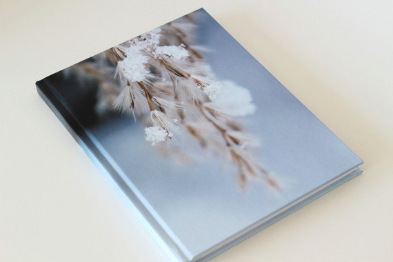 Notebook with photograph of snow covered branches on the front cover