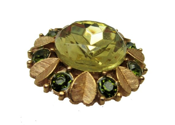 Green rhinestone Brooch Pendant -  Signed Avon - Flower  Glass -   gold Floral leaf pin