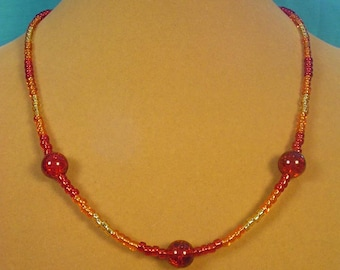 "Beautiful 19"" glass necklace with all of the colors of a firely sunset - N328"