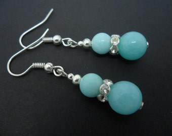 A pair of pretty light blue jade   dangly earrings.
