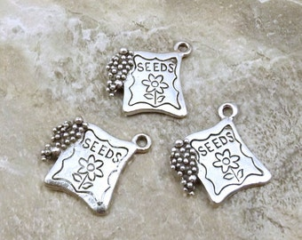 Three (3) Pewter Flower Seed Packets Charms - 1344