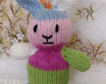 Multicoloured knitted rabbit.