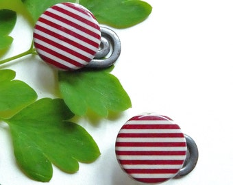 Shirt studs, celluloid, a pair, vintage, striped red & off-white candy striped celluloid, folding swivel backs. c 1920's thereabouts.
