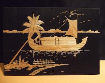 Genuine Rice Straw Art of Balangay Boat Near Land