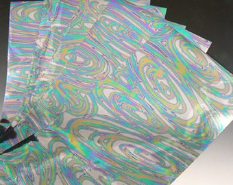 Mylar backed crafting foils by Lisa Pavelka, oil swirls for use on polymer clay, wood, glass and more