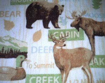 Double towel with moose, duck  deer, and bear. Choice of green or brown tops.