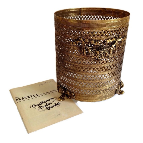 Hollywood regency waste basket gold filigree footed vintage for Gold bathroom wastebasket