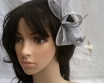 Silver feather Fascinator..on a comb ..Silver Stunning Sinamay and  Feather with Leaves,loops &  Feathers