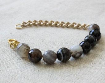 Asymmetrical banded onyx gold chain bracelet